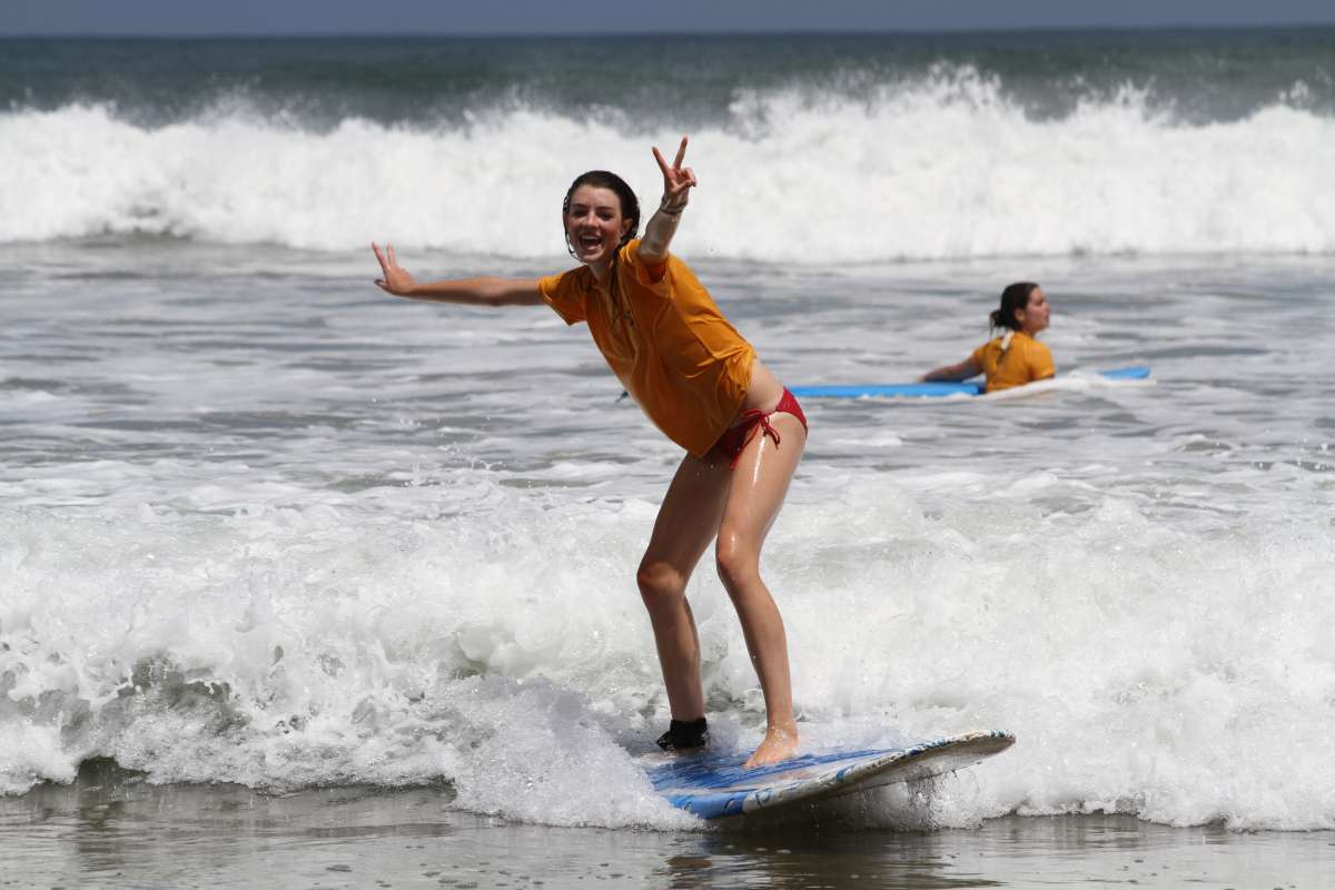 Teen enjoys surfing in Costa Rica on summer student travel program.