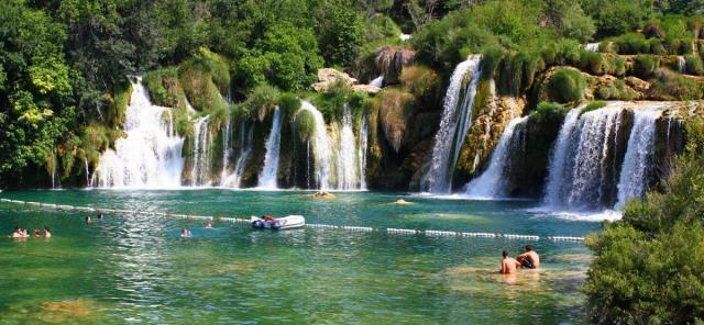 Teens swim in Krka Waterfalls on Croatia summer youth program