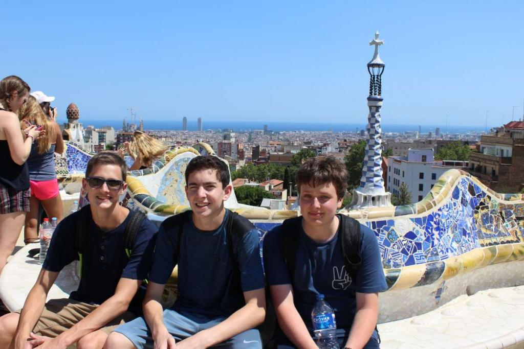 Teenage travelers in Barcelona Park Guell during summer Spanish language immersion program