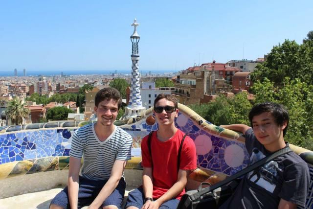 Teen boys explore Parc Guell in Barcelona on summer youth program in Spain