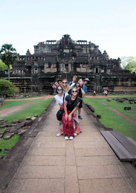 Teenage travelers visit temples during summer youth travel program in Thailand