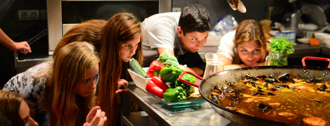 Teens in Spanish cooking class during summer travel program in Barcelona
