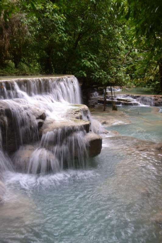 View of waterfalls in Laos seen by teenage travelers during summer youth program in Southeast Asia