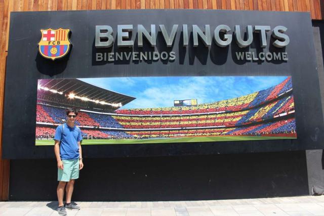 Teenager visits Barcelona soccer stadium on summer Spain travel program