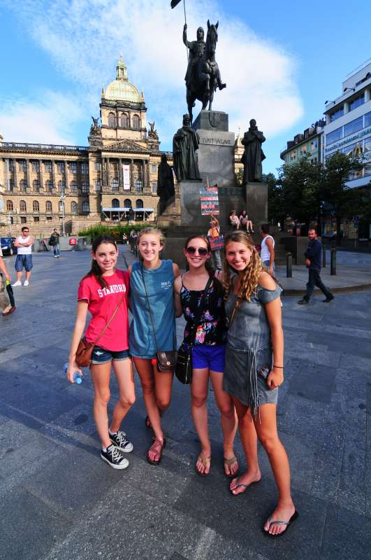 Teen travelers in Wenceslas Square on summer youth program