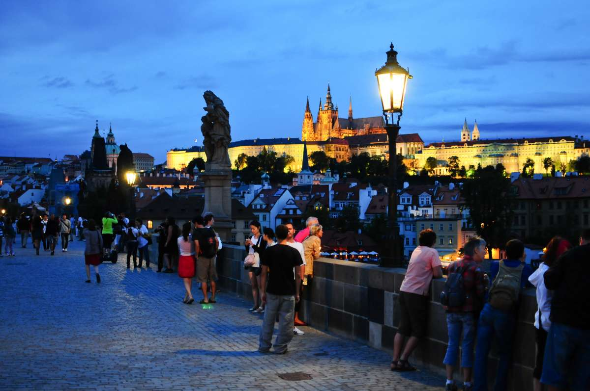 View of Prague at twilight seen from Charles Bridge on teen travel tour to Europe