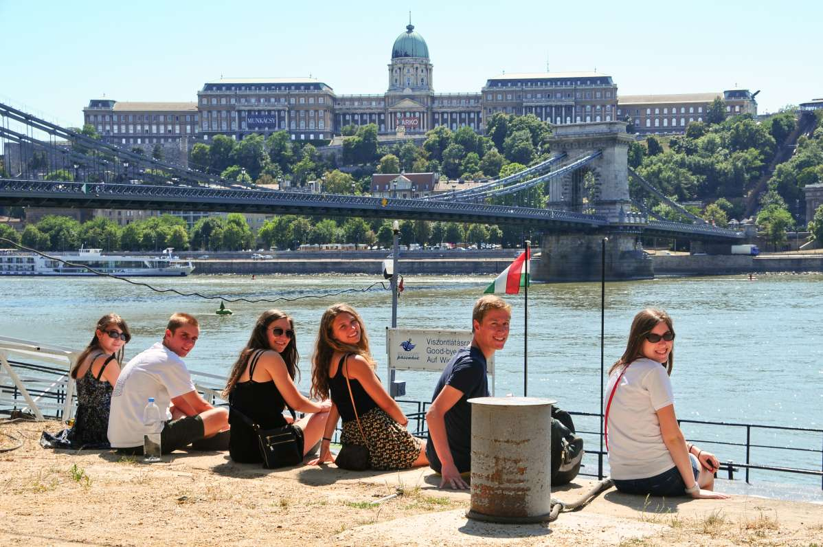 Teens relax on Danube River during summer travel program