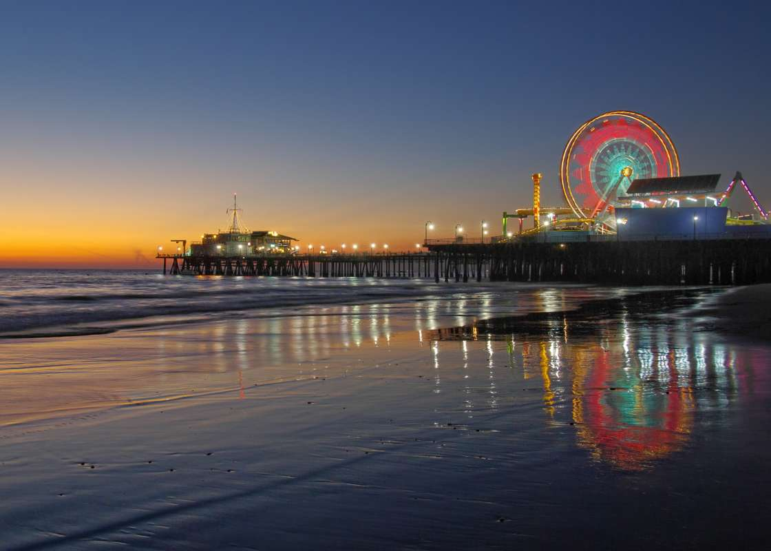 Scenic sunset at the Santa Monica pier on a summer teen tour to California, USA