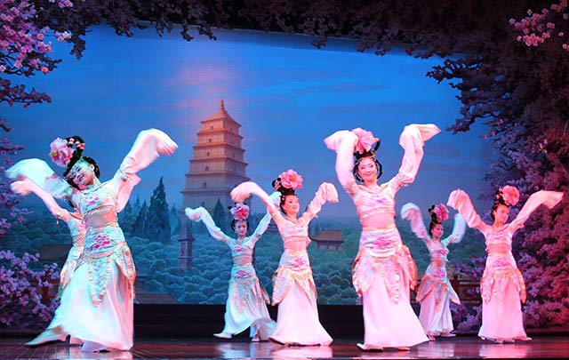 Teen travelers attend a traditional performance in China during their summer travel program.