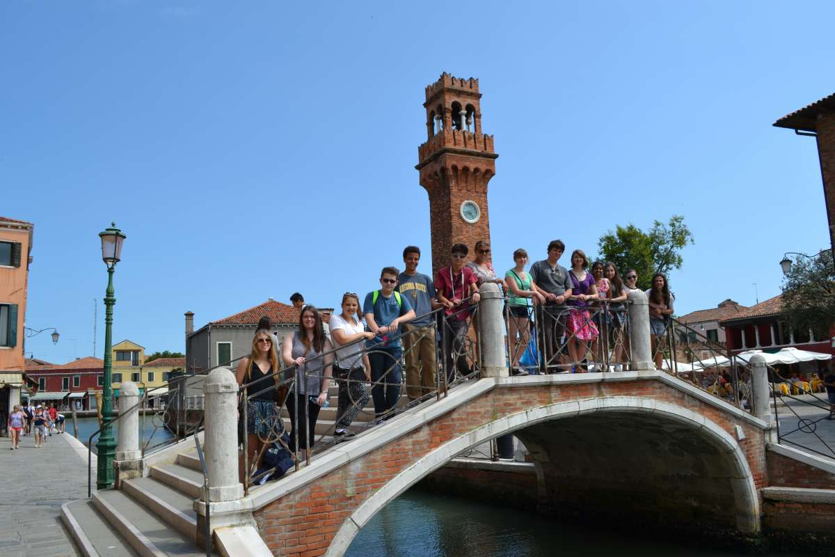 A group of teens pose for a photo in Venice on their summer travel program in Italy.