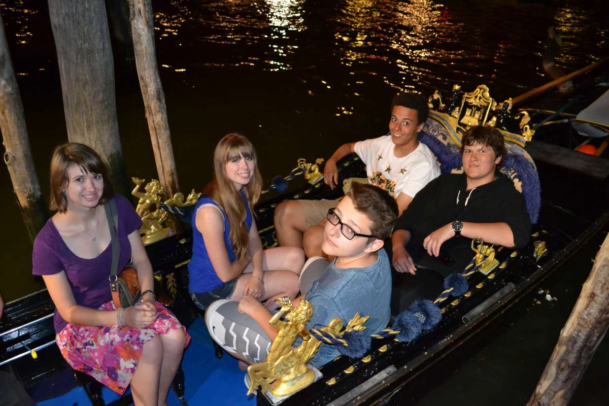 Group of teens go for a ride in a gondola on their summer travel program in Venice, Italy.