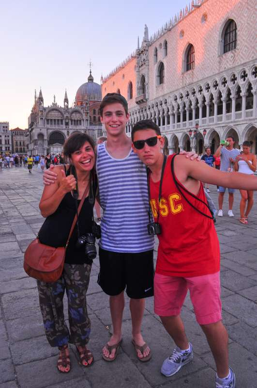 Teens pose for a photo in Piazza San Marco on their summer travel program in Venice, Italy.