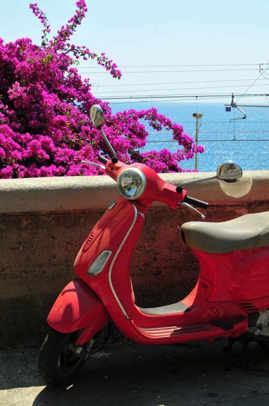 Teens capture an iconic photo of a scooter on their summer student travel program in Italy.