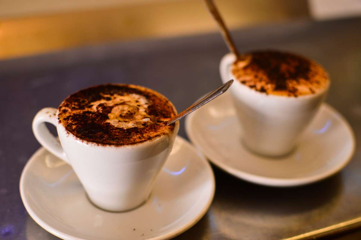 Teens try authentic Italian espresso on their summer travel program in Italy.