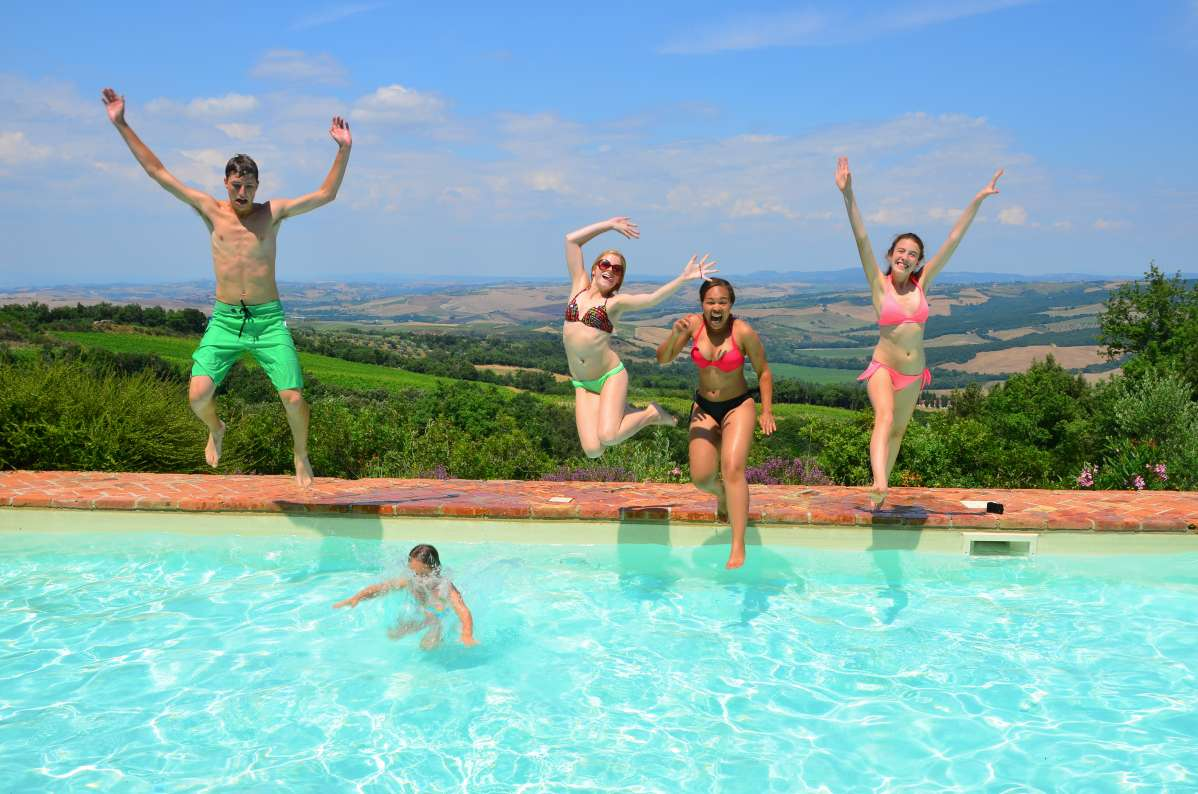 Students dive into the summer at a villa in Tuscany on their summer teen tour to Italy.