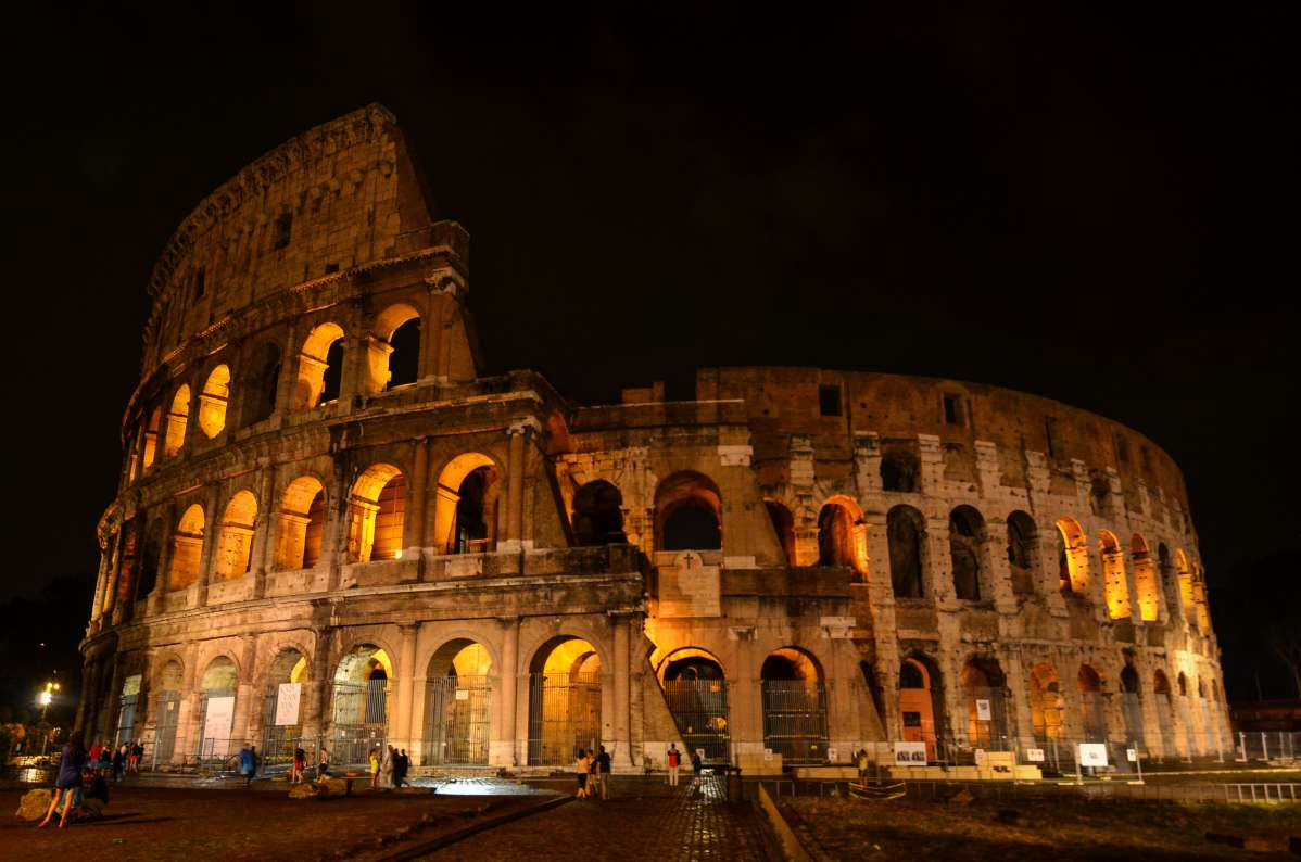 Views of the Colosseum at night on a summer teen tour to Italy.