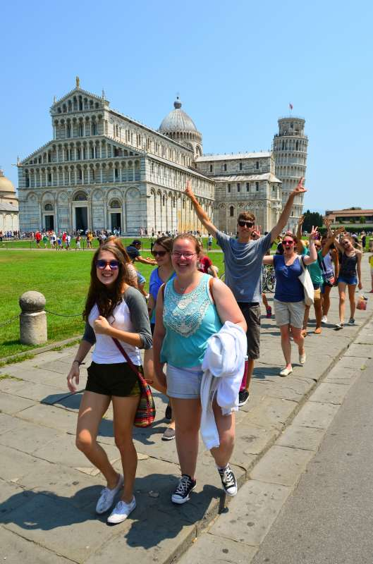 High school students discover the leaning tower of Pisa on their summer teen tour to Italy.