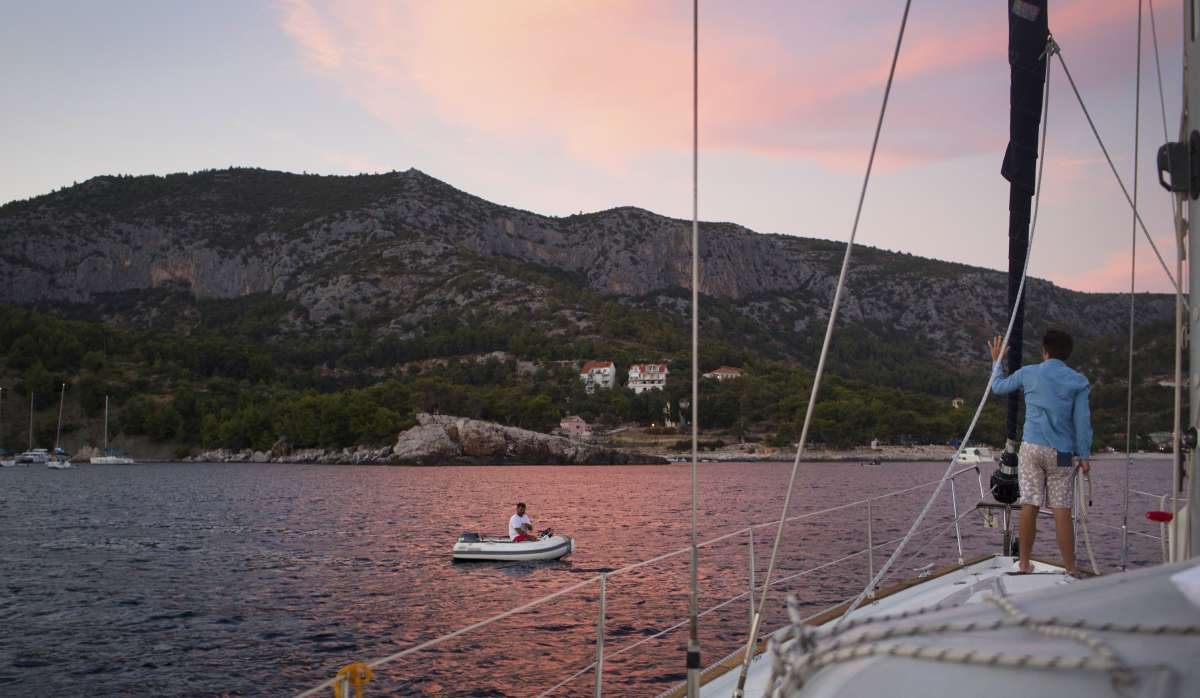 Teens sail through Croatia islands at sunset on summer travel program