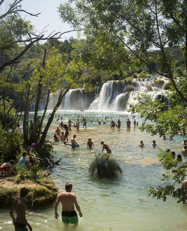 Teens swim in Krka Waterfalls on Croatia summer youth travel program