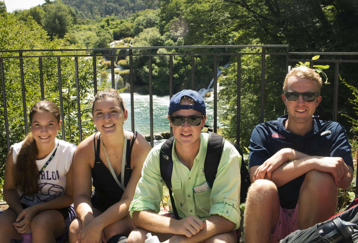 Teens relax at Krka Waterfalls on summer youth travel program to Croatia