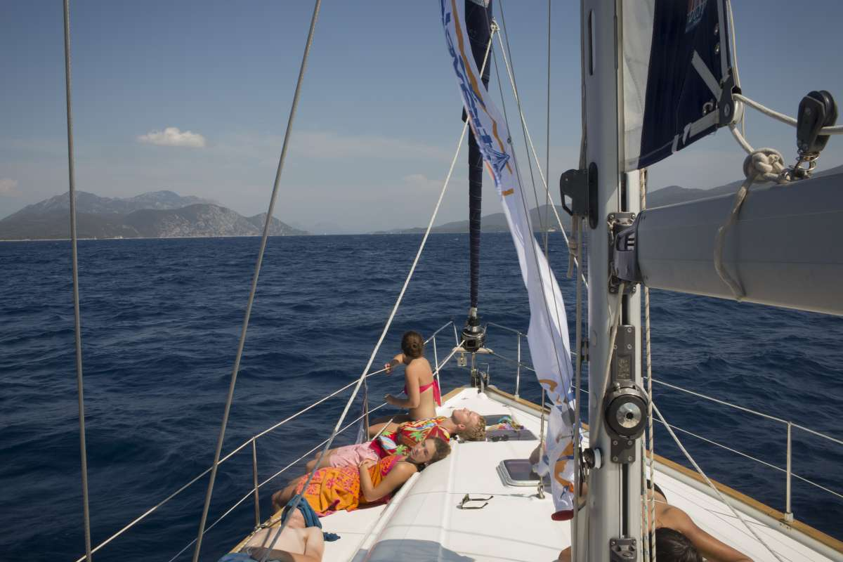 Teen traveler sails through Croatia islands in Adriatic Sea on summer adventure program