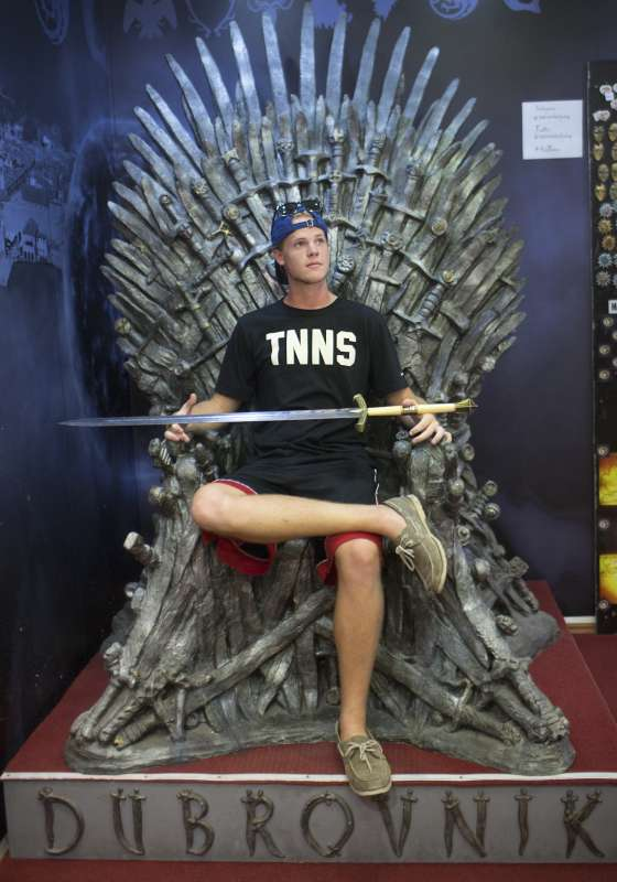 Teen sits on Iron Throne on Game of Thrones tour Dubrovnik summer travel program