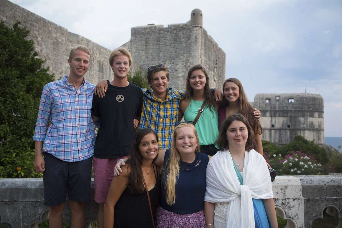 Happy teen travelers in Dubrovnik Croatia on summer youth program