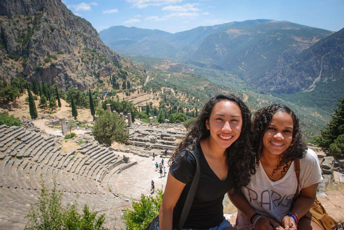 Teen travelers visit ancient archaeological ruins during summer youth travel program in Greece