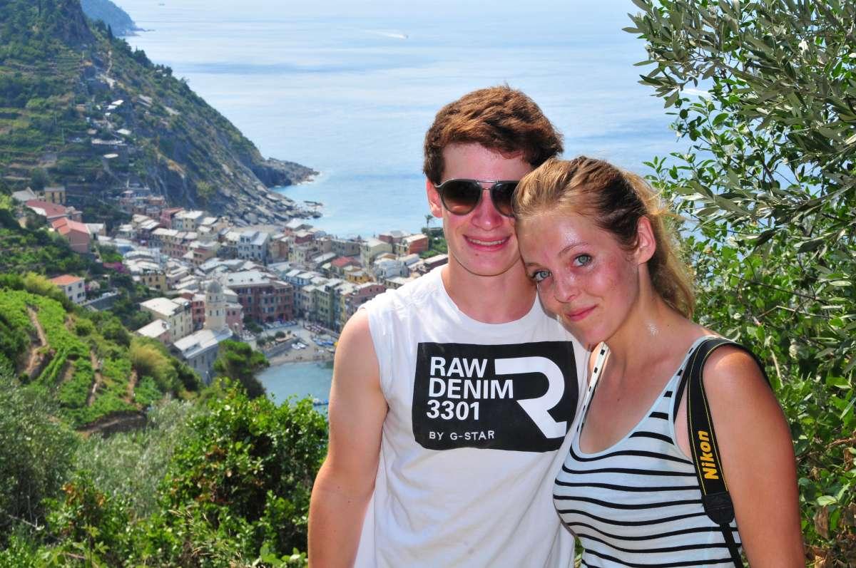 Teenage travelers hiking in Cinque Terre on summer teen travel adventure program