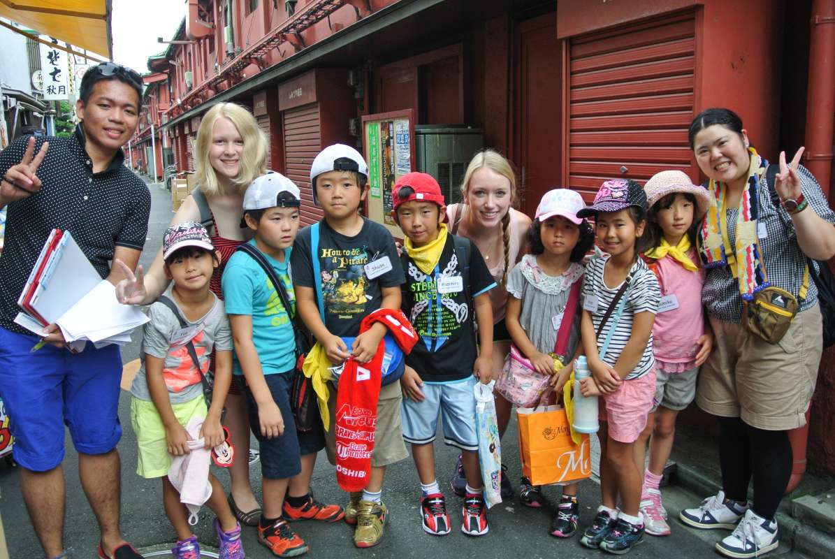 Teenage travelers with local Japanese students during summer youth travel program in Japan
