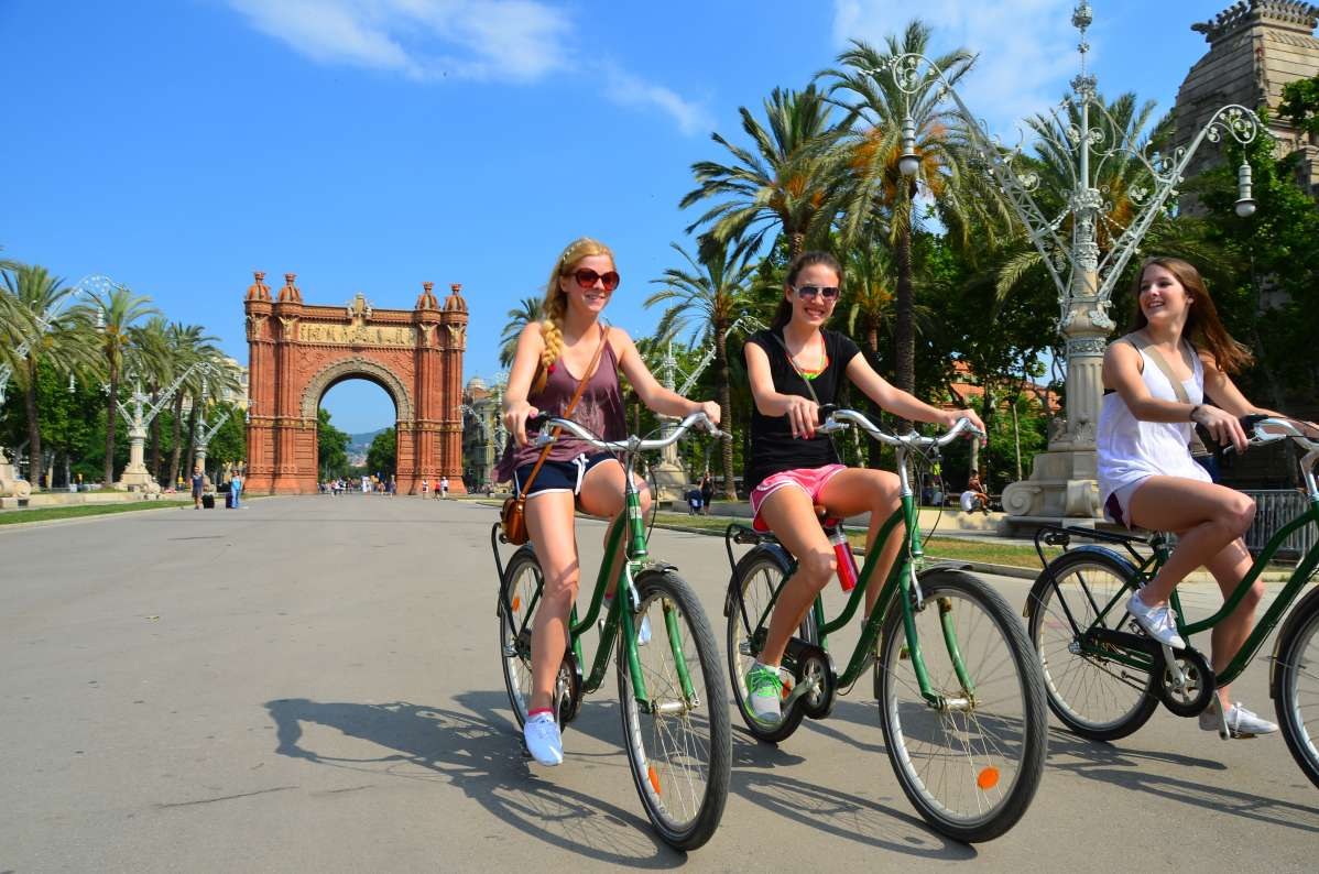 Happy teens biking in Barcelona on Spain summer travel program