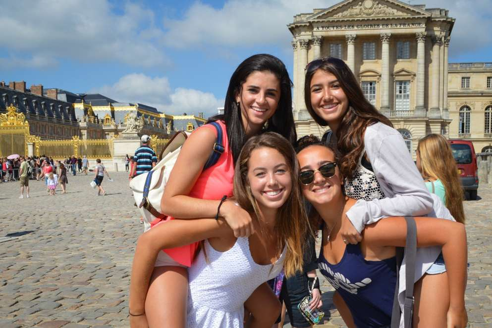 Teen travelers at the Chateau de Versailles during summer French language immersion program in Paris