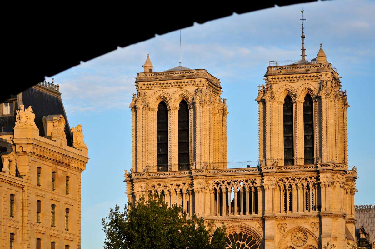View of Notre Dame Cathedral at sunrise seen by teens on summer youth travel program in Paris
