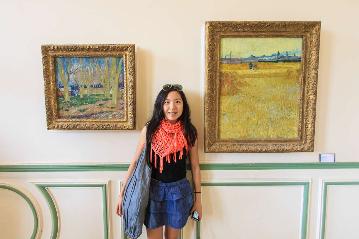 Teen traveler visits impressionist art museum in France on summer program