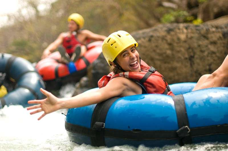 Teens go tubing down river in Costa Rica on summer adventure program.