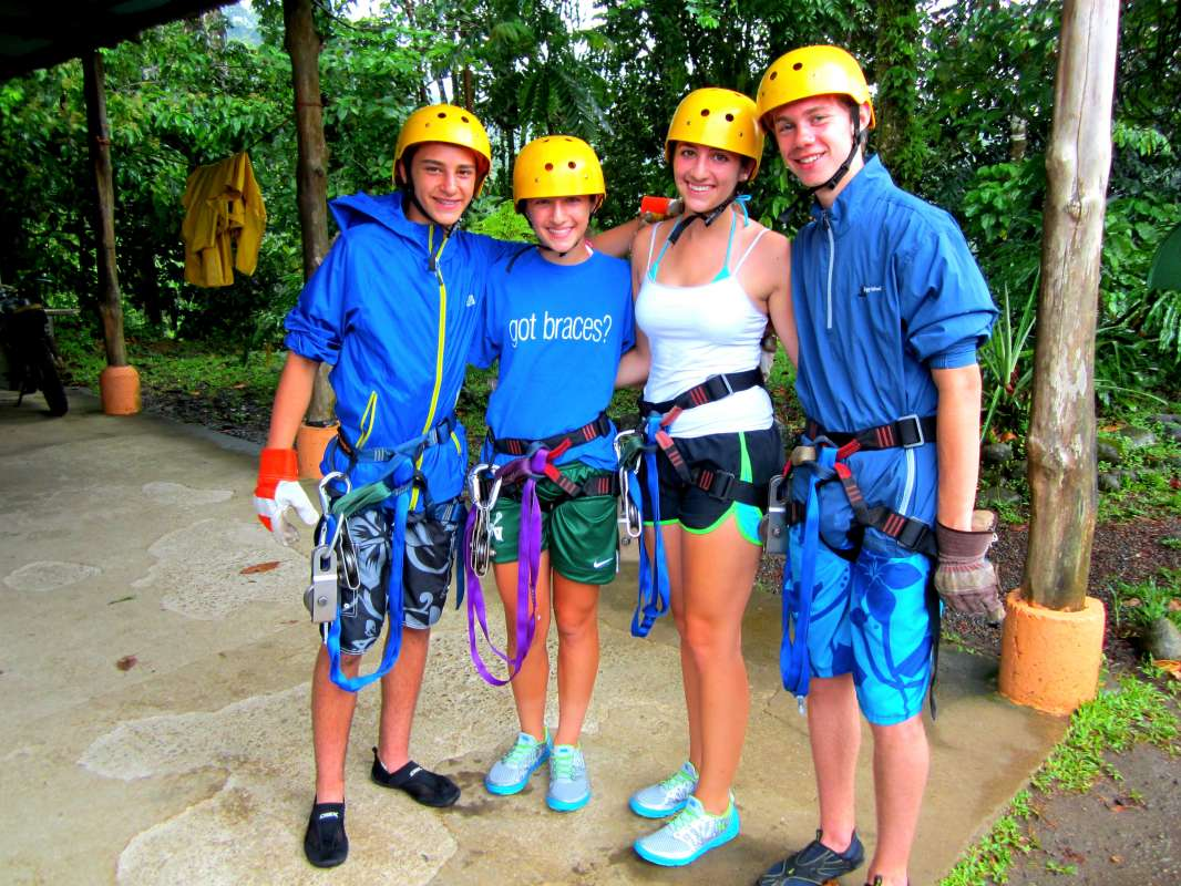 Group of teens get ready to zip-line on their summer adventure tour of Costa Rica.