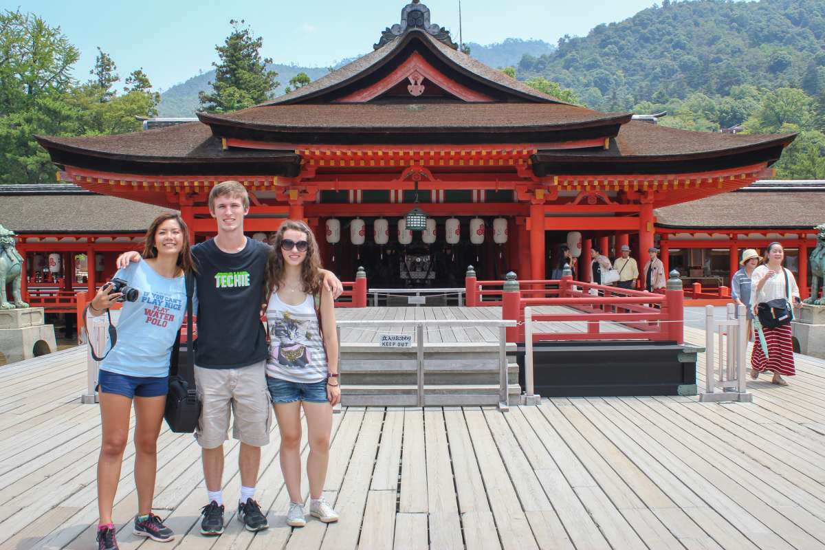 Teenage travelers visit ancient Japanese temple during summer youth travel program in Japan