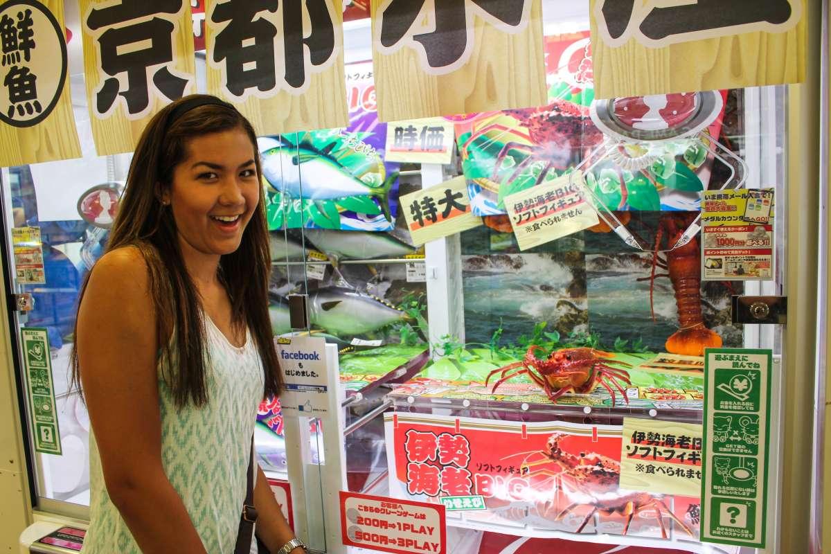 Teenage traveler visits fish market in Tokyo during summer youth travel program in Japan