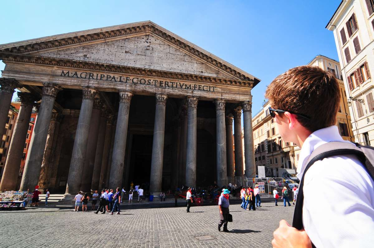 Teen takes in the Pantheon in Rome on their summer high school program to Italy.
