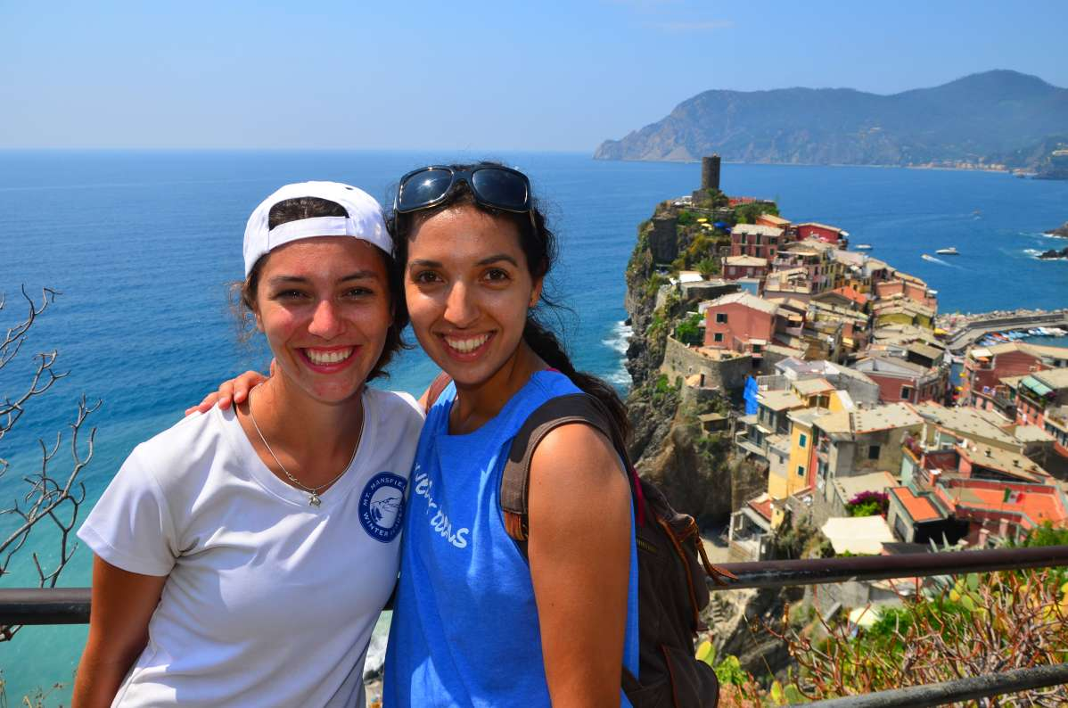 High school teens hike the Cinque Terre and pose with the stunning vistas in Italy on their summer program.