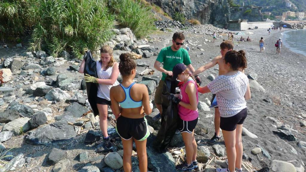 High school students do a beach clean up for service in the Cinque Terre on their summer teen tour to Italy.