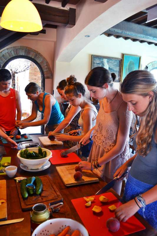 Teens try their hand at making local Italian cuisine in Tuscany on their summer program to Italy.