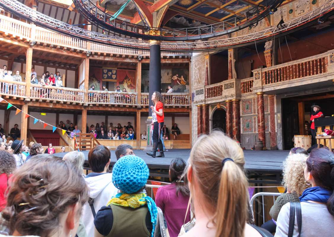 Teenage travelers watch play performed at Shakespeare's Globe Theatre in London on summer youth travel program