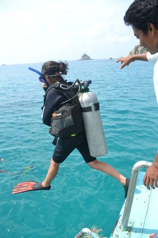 Teenage traveler goes scuba diving during summer youth program in Southeast Asia