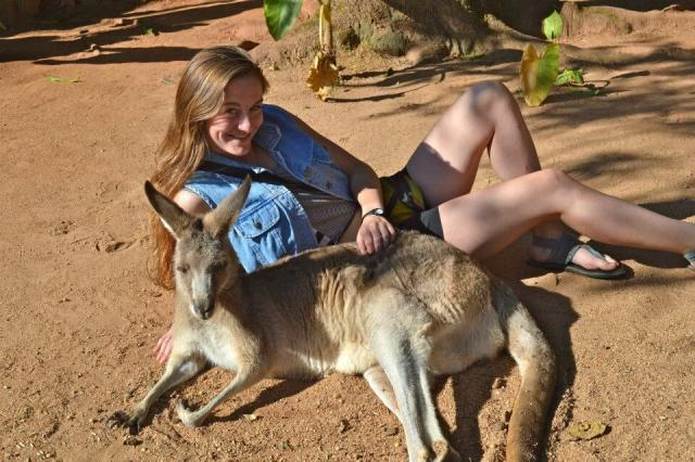 High school traveler poses with a kangaroo on their adventure summer program to Australia.