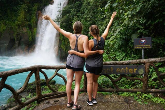 Teens enjoy views of a waterfall on their adventure and service program in Costa Rica.