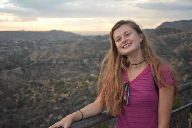 A teen poses for a photo in the scenery of the Southwest on her summer tour of California and Arizona.