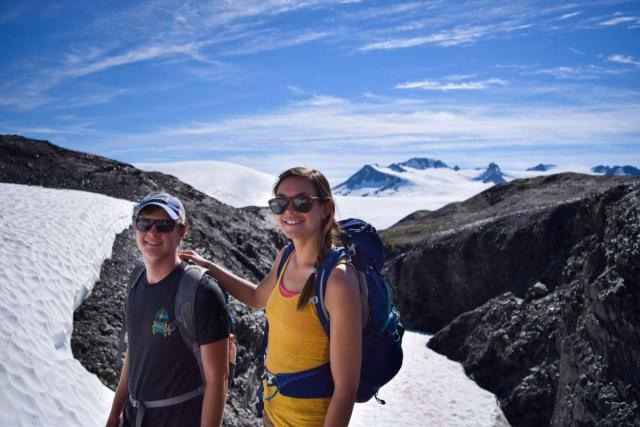 Teenage travelers hiking Alaska wilderness on youth travel program.