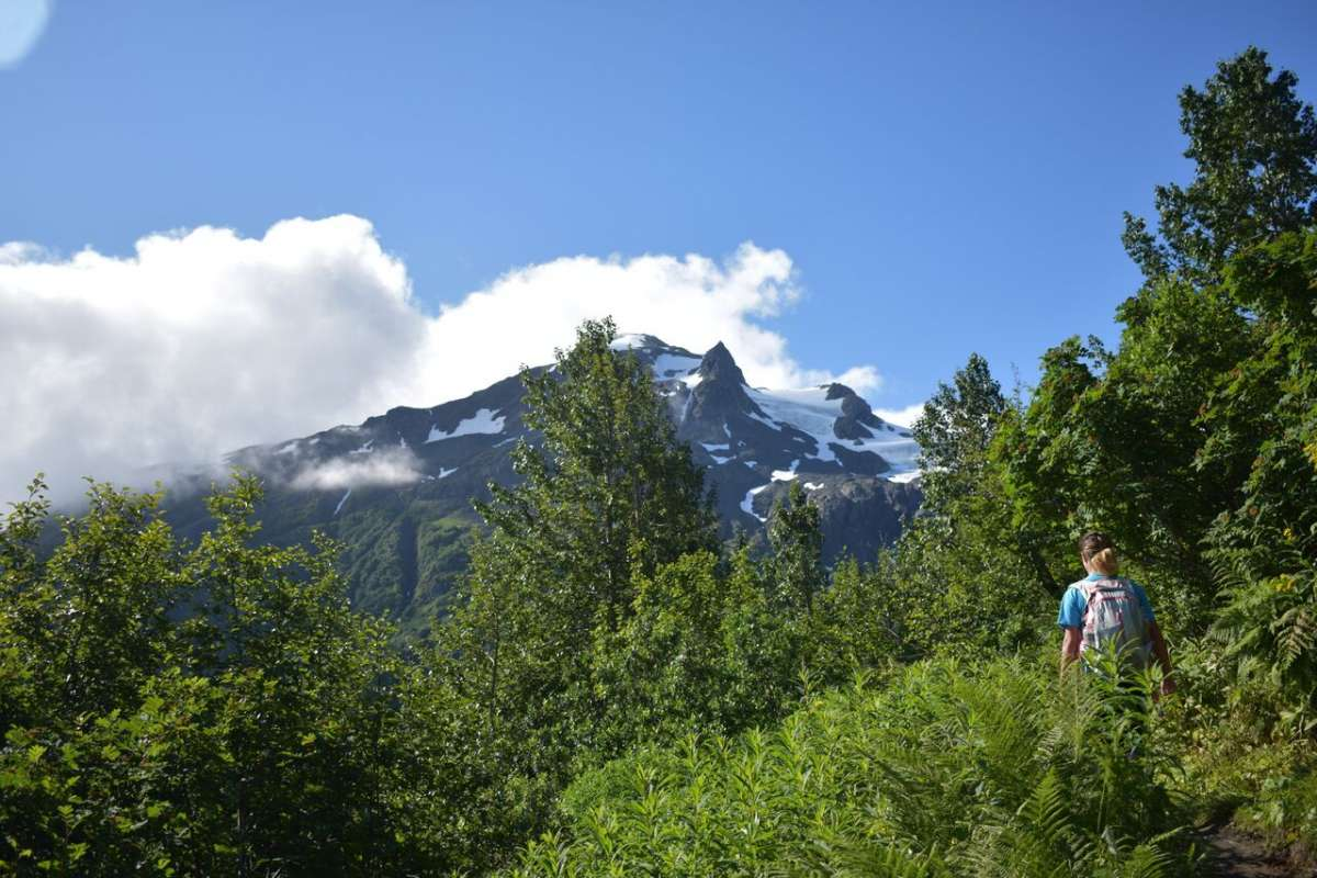 Teen traveler exploring Alaska wilderness on summer youth travel program