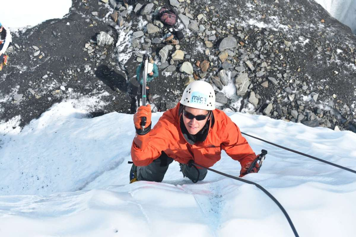 Teen traveler doing ice climb on Alaska youth travel program